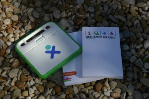 Shows front and back covers of the Laptop Guide for OLPC